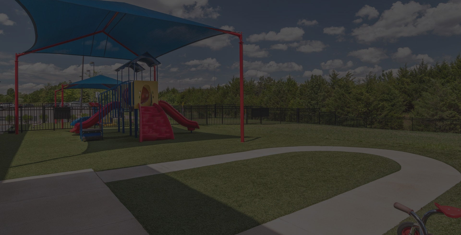 A background image of a playground at Kiddie Academy