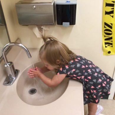Even the little ones are learning how to wash hands.