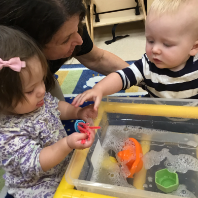 We love it when our teachers put water and soap in our sensory bin it feels just like bath time at home!