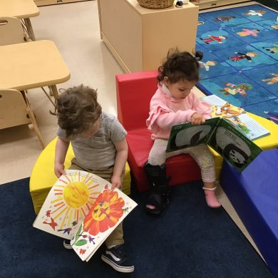 What does early literacy look like? This is it! Our toddlers are forming their own reading community!