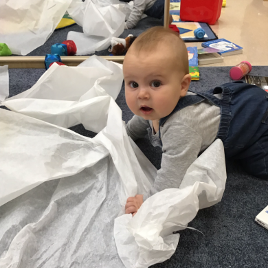 Our babies were so interested in the diaper changing paper that we knew we had to turn it into a sensory activity!