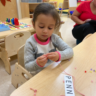 We were not only spelling our name with beads but it was also a challenging fine motor activity to put the tiny beads on the string!