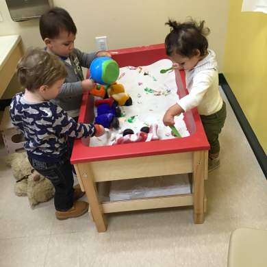 We never know what we are going to find in our sensory table! Today was sand and our favorite toys from around the room!
