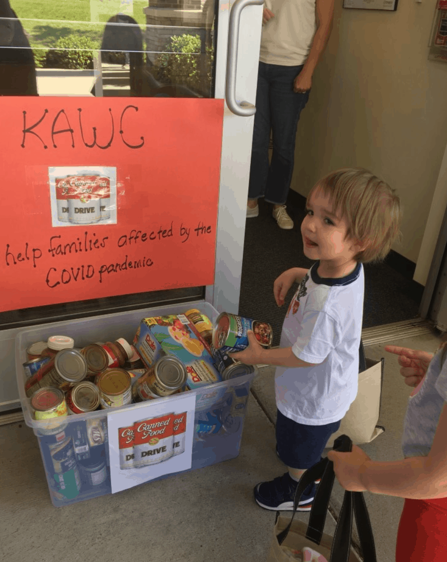 Kiddie Academy student collecting cans
