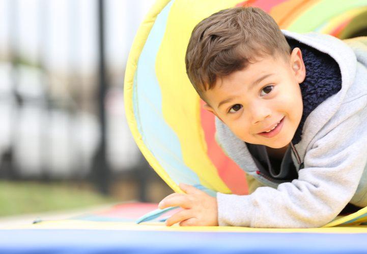 Preschool child playing in the school playground