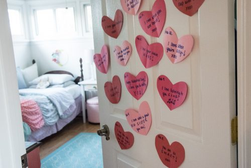 Heart notes on door